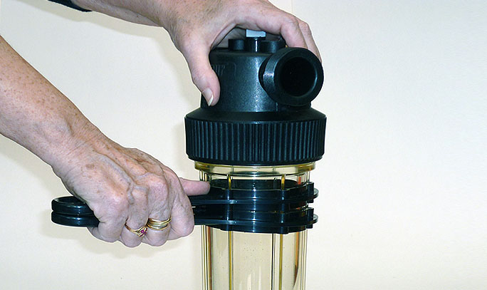 Unlocking the water filter Cintropur with two keys Cintropur